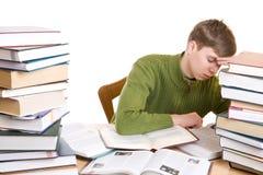 L'allievo addormentato con i libri isolati Immagine Stock