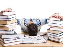 L'allievo addormentato con i libri isolati Immagini Stock