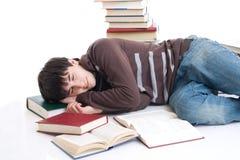 L'allievo addormentato con i libri isolati Fotografie Stock