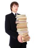 L'allievo con molti libri è scosso Fotografie Stock