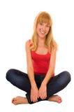 L'allievo femminile casuale si siede sul pavimento Immagini Stock