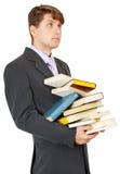 L'allievo tiene molti libri Fotografia Stock Libera da Diritti
