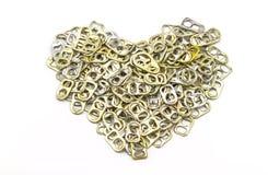 L'alluminio di tirata dell'anello della pila delle latte come forma del cuore indica di nuovo Immagine Stock