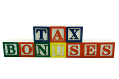 L'alphabet en bois bloque des améliorations d'impôts d'épellation Photo stock