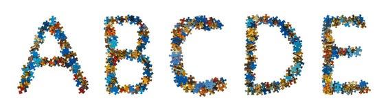 L'alphabet fait en puzzle rapièce - le concept d'éducation Images libres de droits