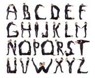 L'alphabet a formé par des êtres humains.