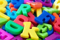 L'alphabet marque avec des lettres le fond Photographie stock