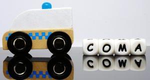 L'alphabet marque avec des lettres orthographier un coma de mot Photographie stock libre de droits