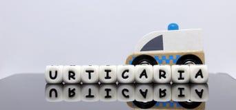 l'alphabet marque avec des lettres orthographier un urticaria de mot Image libre de droits