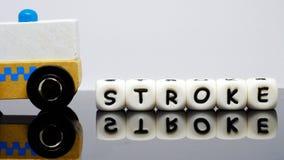 L'alphabet marque avec des lettres orthographier une course de mot Image stock
