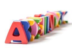 L'alphabet marque avec des lettres un derrière l'autre Photographie stock libre de droits