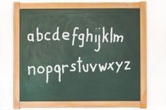 L'alphabet se tient sur un tableau noir Images libres de droits