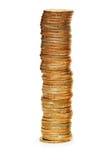 L'alta pila di monete ha isolato la o Immagini Stock Libere da Diritti