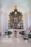 L'altare principale nella chiesa del presupposto di vergine Maria benedetto in Pakrac, Croazia Immagine Stock