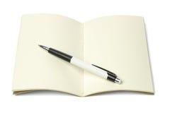 L'amorçage cousent le livre et le stylo à bille Photographie stock libre de droits