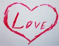 L'amore di parola in un cuore fotografie stock libere da diritti