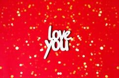 L'amore di parola voi su un fondo rosso con le luci fotografie stock