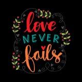 L'amore non viene a mancare mai l'iscrizione della mano illustrazione di stock