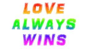 L'amore vince sempre scritto con l'acquerello fotografia stock libera da diritti