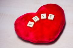 L'amour défini dans grattent des lettres Photographie stock