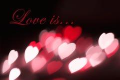 L'amour d'effet de bokeh de coeurs de fond de carte postale est Photographie stock