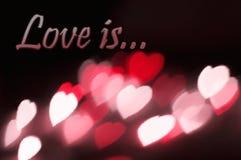 L'amour d'effet de bokeh de coeurs de fond de carte postale est Image libre de droits
