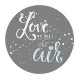 L'amour d'expression de calligraphie est dans le ciel Conception romantique pour la carte, la carte postale ou l'affiche Photo libre de droits