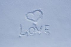L'amour d'inscription dans la neige Photographie stock libre de droits