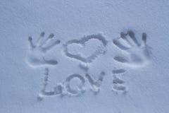 L'amour d'inscription dans la neige Images libres de droits