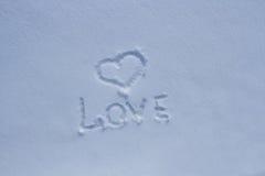 L'amour d'inscription dans la neige Photographie stock