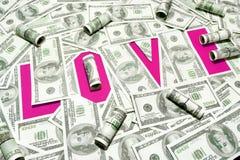 L'amour d'inscription une couleur pourpre sur le fond de vieux billets d'un dollar Images libres de droits