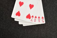 L'amour de mot écrit avec jouer des cartes Photographie stock
