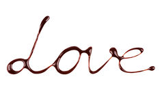 L'amour de mot écrit par le chocolat liquide sur le blanc Photos libres de droits