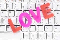 L'amour de mot au-dessus du clavier Image stock