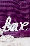L'amour de mot avec le coeur Photo stock