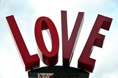 L'amour de mot avec les majuscules Photographie stock