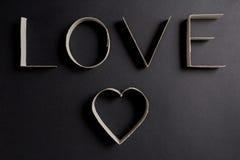 L'amour de mot composé des lettres de carton Photos stock