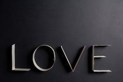 L'amour de mot composé des lettres de carton Photographie stock