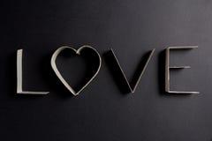 L'amour de mot composé des lettres de carton Photographie stock libre de droits