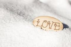 L'amour de mot dans la neige Photos stock