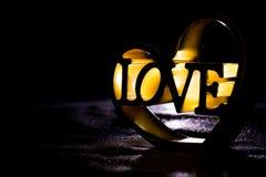 L'amour de mot dans un coeur Photos libres de droits