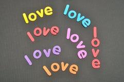L'amour de mot dans un grand choix de couleurs Photographie stock libre de droits