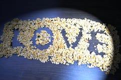 L'amour de mot est écrit d'une granola utile Image libre de droits