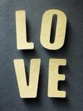 L'amour de mot sur le fond de papier Images libres de droits