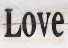 L'amour de mot sur un fond en bois de vintage Photo stock