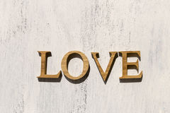 L'amour en bois se connectent le fond en bois blanc Images libres de droits