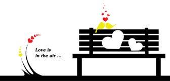 L'amour est dans la carte cadeaux de Saint-Valentin d'air Images libres de droits