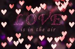 L'amour est dans le ciel avec le bokeh de coeur Image stock