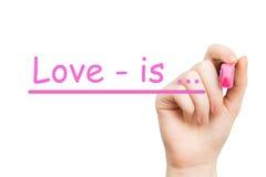 L'amour est… marqueur de rose Photographie stock libre de droits