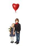 L'amour est… marqueur de rose sur le fond blanc Photographie stock